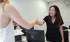 Team member shaking hands with patient