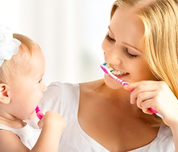 mommy and baby brushing teeth together