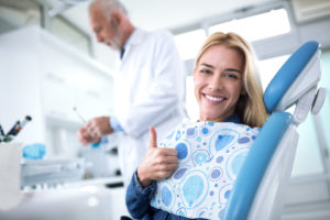 Smiling woman at dentist's office