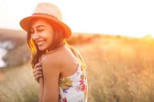 Smiling woman in field