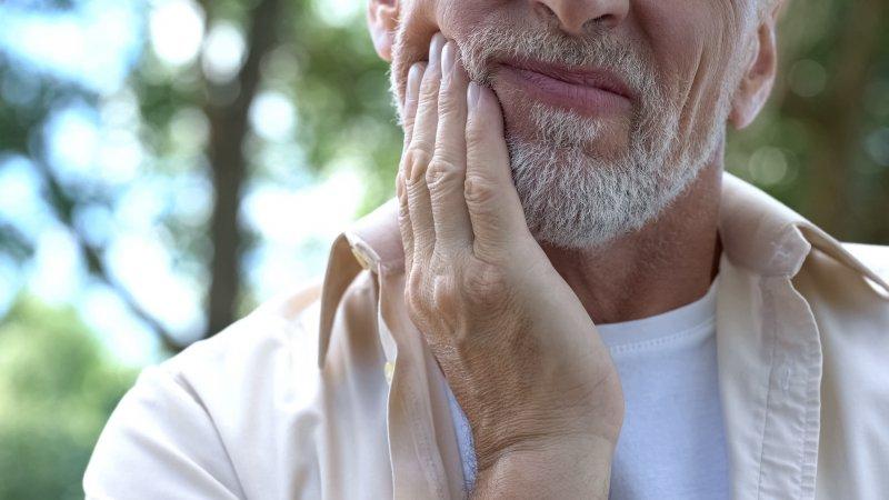 Closeup of senior man experiencing oral pain